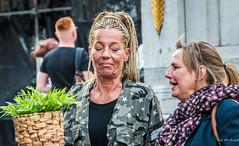 2018 - Germany - Düsseldorf - Street Conversation (Ted's photos - Returns Late November) Tags: 2018 cropped düsseldorf germany nikon nikond750 nikonfx tedmcgrath tedsphotos vignetting two duo pair females ladys ladies smirk lips teeth dents dusseldorfgermany dusseldorf plant couple carlsplatzmarkt