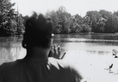 Taking a picture... (Penguindad) Tags: water sky lake tree person picture fulda hessen germany daylight zenit agfaphoto apx100 iso100 analogue analog photography fotografie