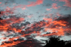 Red and Blue Contrast (katyearley) Tags: nature 55mm t6 rebel canon evening storm opposite sunset clouds contrast blue red