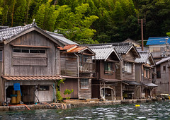 Funaya fishermen houses, Kyoto prefecture, Ine, Japan (Eric Lafforgue) Tags: architecture asia boathouse buildingexterior builtstructure coastline colorimage cultures day fishingindustry funaya harbour horizontal house ine japan japan18201 journey kyotoprefecture nopeople outdoors photography row scenics sea tourism traditionalbuilding tranquilscene tranquility traveldestinations village water waterfront woodmaterial wooden jp
