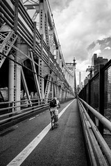 Breaking Away #2 (Kenneth Laurence Neal) Tags: newyorkcity bridges queensborobridge urban street cloudy bicycles bicyclist nikon nikond5200 blackandwhite monochrome silverefexpro2 people