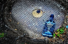 PINNACLE VODKA - WHERE GOOD FRIENDS CONGREGATE (panache2620) Tags: liquor vodka blue urban city street streetphotoography photodocumentary photojournalism art minneapolis minnesota eos canon bottle plastic
