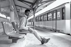 Waiting For A Train (sdupimages) Tags: gare trainstation rue street noirblanc blackwhite portrait bw nb transport transportation metro subway underground train man bg composition perspective paris parisien parisian