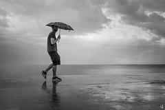 First rain (tzevang.com) Tags: rain umbrella walking greece athens bw absoluteblackandwhite