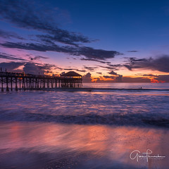 Dawn Patrol (Thüncher Photography) Tags: fujifilm fuji gfx50s fujigfx50s mediumformat longexposure scenic landscape waterscape oceanscape nature outdoors sky clouds colors reflections beach sunrise pier surfing cocoabeachpier cocoabeach spacecoast florida kellyslater