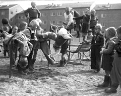 Almost enough equipment (theirhistory) Tags: boy children child kid girl school group class pupils students form play sand earth jacket trousers shoes wellies boots hat cap dungarees