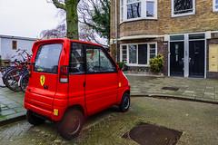 Urban Ferrari (Walimai.photo) Tags: car coche ferrari small pequeño urbano urban city ciudad amsterdam street calle netherlands holanda holland lx5 lumix panasonic red rojo