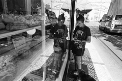 Baked goods (ewitsoe) Tags: mono monochrome lisbon film analago analogue nikonfm2 fm2 ilford hp5plus films frames street portugal summer workshop camera urban reflection grain tone bright contrast scenes cinematic reflect storefront lady woman female reflecting cityscape atmosphere