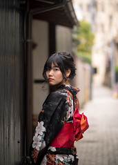 Young woman in Yukata looking over shoulder on traditional Japan (Apricot Cafe) Tags: img47961 asia asianandindianethnicities canonef85mmf18usm healthylifestyle japan japaneseethnicity kagurazaka kimono tokyojapan anticipation beautifulwoman blackhair candid carefree charming cheerful colorimage day enjoyment fashion happiness independent leisureactivity lifestyles longhair lookingatcamera lookingovershoulder oneperson oneyoungwomanonly onlyjapanese outdoors people photography portrait realpeople relaxation smiling street summer sustainablelifestyle threequarterlength traditionalclothing travel vacations wall women youngadult yukata