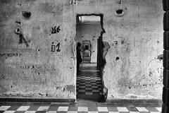 im Museum (julie.kate) Tags: bw monochrome museum historical site prison walls cambodia