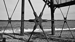 Attraction (David Ian Ross) Tags: timber 1863 braced hexagonal structure lighthouse east coast town dark monochrome heritage tendring peninsula iron staircase horizon rust physics law attraction bonds elements