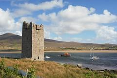 Achill island. (carolinejohnston2) Tags: castle tower sea coast shore summer boats lifeboat landscape ireland comayo wildatlanticway mountain sky grass outdoors
