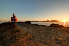 Punta Robaleira lighthouse (RuiFAFerreira) Tags: sunset sun spain light landscape lighthouse rocks island red galicia canon efs1018mmf4556isstm colors