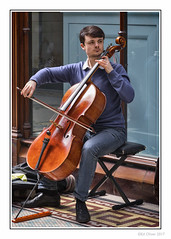 The Musician (Seven_Wishes) Tags: newcastleupontyne photoborder outdoor jo cb jg ag canoneos5dmarkiv canonef24105mm streetphotography centralarcade musician classicalmusician cello doublebass musicalinstrument man young sitting portrait candid window reflection stubble beard music edoliverphotography 2017 views3k