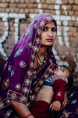Mother & Sleeping Child During Holi, Vrindavan India (AdamCohn) Tags: adamcohn hindu india vrindavan child eyes holi mother pilgrim pilgrimage saree sari होली