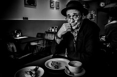 Empty plates and coffee cups (sophie_merlo) Tags: bw mono monochrome blackandwhite portrait people models man london cafe food lonely england sadness