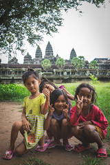 In front of Angkor Wat... (Syahrel Azha Hashim) Tags: portrait ancientarchitecture expression sony shallow pose simple building editorial getaway details portraiture a7ii 35mm 2015 holiday architecture local sonya7 unesco ilce7m2 streetphotography dof heritage fun touristattraction smile asia people kid humaninterest handheld localpeople colorimage vacation street children light siemreap naturallight moment colorful temple beautiful travel angkorwat syahrel prime colors kids cambodia angkor happy detail