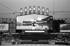 Southpaw (Crawford Brian) Tags: southpaw chicagowhitesox mascot sign baseball scoreboard stadium bw film analog kodak trix nikon fm camera nikonfm sports illinois chicago monochrome mlb night lights guaranteedratefield comiskeypark uscellularfield southside explodingscoreboard thedarkroomcom