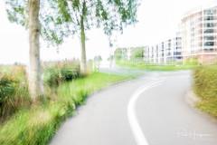 Getting into Mijdrecht (PaulHoo) Tags: fujifilm x70 2018 mijdrecht speed impressionism fineart shaky longshutter longexposure movement road path flat houses