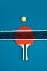 Table tennis or ping pong rackets and ballse. (niekrasova) Tags: above action activity background ball blue challenge championship closeup compete competitive copyspace cyan design equipment exercise fast forehand fun game handle indoors inside leisure line match minimal minimalism net nopeople object orange paddle pair ping pingpong play playing pong racket recreation rubber sport table tabletennis tennis win wooden