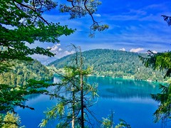 Hintersteiner See from an elevated viewpoint in the forest near Kufstein in Tyrol, Austria (UweBKK (α 77 on )) Tags: lake hintersteiner see water mountains trees forest blue green sky clouds alps tyrol tirol austria europe europa iphone österreich kufstein view viewpoint elevated