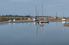Grounded (David Feuerhelm) Tags: coast sand sea boats masts shore yachts blue reflections norfolk wellsnextthesea serene nikon d750 70200mmf28