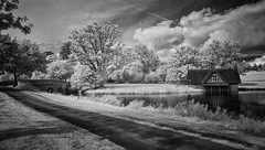 The Boathouse at Carton (marksedgwick55) Tags: trees bridge composition contrast blackwhite clouds water cartonestate carton kildare ireland infrared monochrome sky dramatic drama estate landscape boathouse house boat building