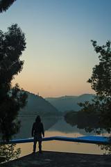 Sunrise D'Ortiga (Journey of Masa) Tags: lake landscape silhouette water river sun sunrise colors beautiful man person mountains nature trees