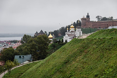 View of the Nizhny Novgorod Kremlin. (Oleg.A) Tags: grass autumn nizhnynovgorod church nature water city cityscape clouds morning oldtown river tower orthodox nizhnynovgorodkremlin style park wall volga shadow landscape russia cloudy brick overcast materials town exterior colorful old antique ancient cathedral sky green building outdoor design architecture