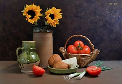 Simplicity of Living (Esther Spektor - Thanks for 12+millions views..) Tags: stilllife naturemorte bodegon naturezamorta stilleben naturamorta composition creativephotography tabletop simplicity tomatoes cheese bread roll sunflowers basket bowl jar pitcher onion slice pottery ceramics wicker ambientlight green red white yellow beige brown estherspektor canon