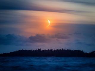 Crescent moon above the sea