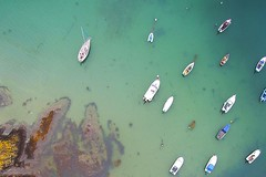 little boats (Kyle TKT) Tags: boats water sea dronephotography