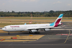 OO-SCX Airbus A340-300 Eurowings opb Brussels Airlines DUS 2018-07-31 (28a) (Marvin Mutz) Tags: ooscx eurowings europe ew ewg brussels airlines airbus a340300 dus eddl düsseldorf international nordrheinwestfalen germany aviation planespotting avgeek aircraft airplane aeroplane plane pilot cockpit crew passenger travel transport jet jetliner airline airliner wings engines airport runway taxiway apron clouds sky flight flying