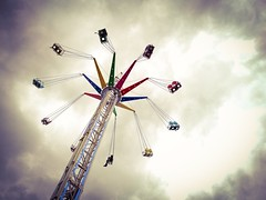 Ride (HonleyA) Tags: fair ride fairground uk yorkshire skyline sky clouds spin