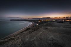 Last glow over the Sagres Point (Sizun Eye) Tags: sagres algarve portugal twilight dusk bay sea ocean atlantic beach lights glow sizuneye nikond750 nikon1424mmf28 a 1424mm nikkor le longexposure poselongue