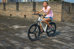 2018 Xi'an - On and Around the Old City Walls 59 (C & R Driver-Burgess) Tags: xian 西安 wall city towers ancient historical stone defense tourist cycllist woman girl battlements preteen pink tshirt young bicycle white walls pavers blue shorts