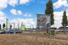 Billboards. Haarlem, Spaarnwoude (natures-pencil) Tags: billboards signs haarlerm spaarnwoude nederland netherlands advertising empty history industry photo trees grass clouds sky cars parking strange scrub drought dry lamps lighting