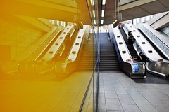 Yellow Peril (Douguerreotype) Tags: underground city station uk metro escalator british england tunnel stairs gb subway urban britain london symmetry reflection wall people steps tube