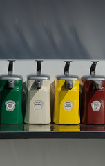 condiments (dotintime) Tags: condiments relish mayo mustard ketchup tray counter fair shelf nozzle spout color container dotintimemeganlane