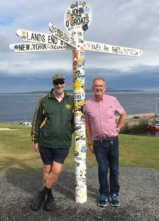 Two guys delighted to be in John O' Groats at the top of Britain.