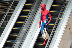 Spidey escalates (Mister Oy) Tags: comicon cosplay guardiansofthegalleries wigantowncentre street streetphotography fujixpro2 fuji50140mmf28 spiderman marvel
