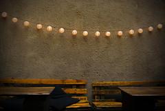 chain of lights (bobinskiii) Tags: krakow cracow poland europe outside beergarden bar bars brown lights chain lantern lanterns wooden bench benches seating cushion