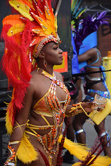 DSC_8290 Notting Hill Caribbean Carnival London Exotic Colourful Orange and Yellow Costume with Ostrich Feather Headdress Girls Dancing Showgirl Performers Aug 27 2018 Stunning Ladies (photographer695) Tags: notting hill caribbean carnival london exotic colourful costume girls dancing showgirl performers aug 27 2018 stunning ladies orange yellow with ostrich feather headdress