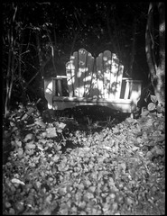outdoor loveseat, in the shadows, West Asheville, NC, Zenobia, Arista.Edu 200, Kodak TMAX develper, 9.18.18 (steve aimone) Tags: loveseat outdoorfurniture furniture shadows intheshadows westasheville northcarolina zenobia neohesper75mmf35 neohesper hesper aristaedu200 kodaktmaxdeveloper blackandwhite monochrome monochromatic