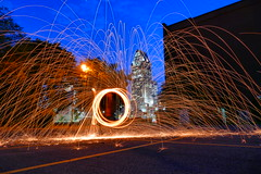 Twilight Fire Spinning in Downtown Montreal Qc (@mjmantis Montreal Urban Photos) Tags: montreal firespinning twilight urban night landmark mtl lightpainting citylights canada cityscape explorecanada streetphotography streetart urbanart nightphotography nighttime nightphoto outdoor