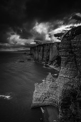 "Falaise d'Amont (Cliffs of Amont) moody, brooding, fine art black & white view. Étretat, Seine-Maritime, Haute-Normandie, Normandy, France (grumpybaldprof) Tags: bw blackwhite ""blackwhite"" ""blackandwhite"" noireetblanc monochrome ""fineart"" ethereal striking artistic interpretation impressionist stylistic style contrast shadow bright dark black white illuminated ""wideangle"" ultrawide étretat seinemaritime hautenormandie normandy france arches ""portedaval"" ""portedamont"" ""portedemanneporte"" laiguille ""theneedle"" ""eugèneboudin"" ""gustavecourbet"" ""claudemonet"" ""paysdecaux"" ""alabastercoast"" ""chapellenotredamedelagarde"" ""thewhitebird"" ""loiseaublanc"" ""lachapellenotredamedelagarde"" ""falaised'amont"" ""thegardensofetretat"" ""lesjardinsd'etretat"" alabaster cliffs needles mood moody atmosphere coast coastline rocks drama clouds threatening"