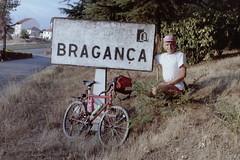 Parked (cyclingshepherd) Tags: 1988 europe europa portugal bragança braganza braganca bicycle bike bicicleta bicicletta velo vélo rad fahrrad fiets evans fwevans cap pink august cyclingshepherd bag saddle bidon bidons vtt atb btt mountainbike sign roadsign reynolds 531 suntour roadside parked estaçionada trees road blackburn