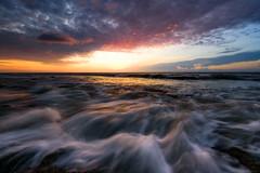 Sunrise at the Rocks (Matt Creighton) Tags: rocks sunrise morning beach ocean seashore sky water movement