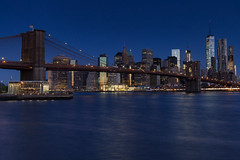 Kind of Blue (Bob90901) Tags: blue bluehour brooklynbridge newyork civiltwilight spring newyorkcity longexposure cityscape skyline rpg90901 east river waterfront architecture skyscraper buildings water sky manhattan oneworldtradecenter brooklynbridgepark empirefultonferrystatepark janescarousel city morning bridge canon 6d canonef2470mmf28liiusm 2016 april 0537