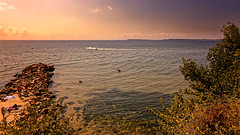 A Sunny View On A Warm Day (Alfred Grupstra) Tags: sea nature sunset beach coastline summer water landscape sky scenics outdoors sunlight sun beautyinnature blue tranquilscene dusk reflection vacations travel 913 bulgaria